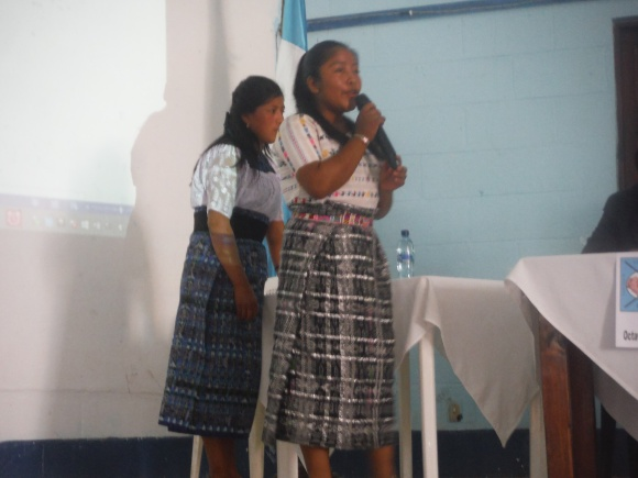Griselda and Lilian distributing proposals for candidates to sign